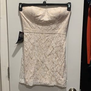 New with tags Bebe white lace mini dress w/ ivory
